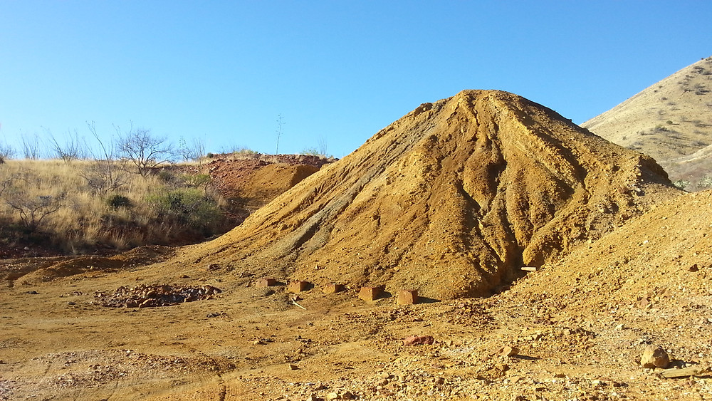 Large tailing pile that smells like sulfur.