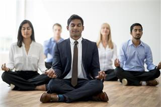 320-585085140-business-people-meditating