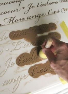 Painting a mylar stencil with a sponge