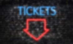 Tickets neon sign on dark brick wall bac