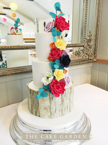 Wood bark panels and colourful sugar flowers