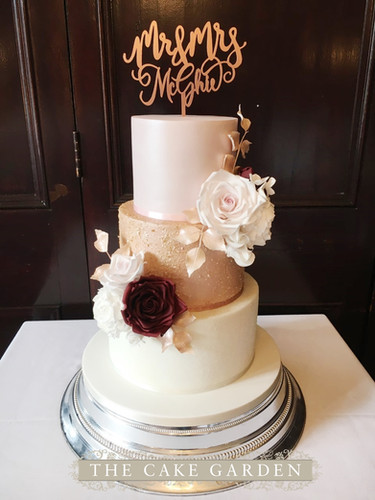 Pink luster and gold sequins with sugar flowers
