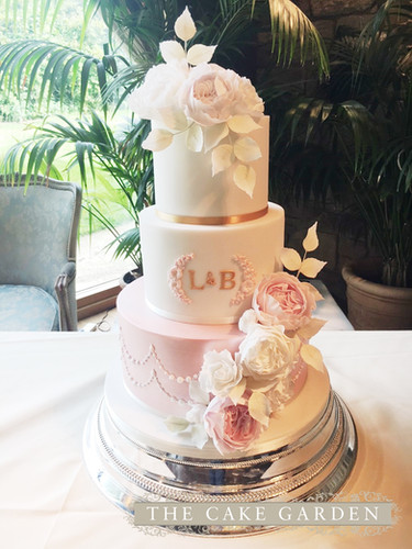 3 tier monogram and pearls with sugar flowers