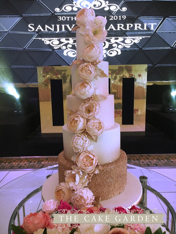 5 tier rose gold and peach pearls with sugar flowers