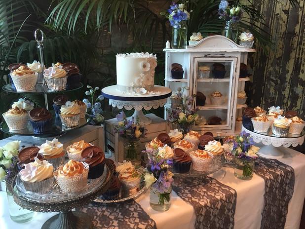Cupcake and small wedding cake dessert table.  Jaffa Orange, Strawberry Champagne & Caramel Apple