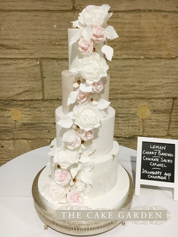 4 tier marbled iced cake with sugar flowers