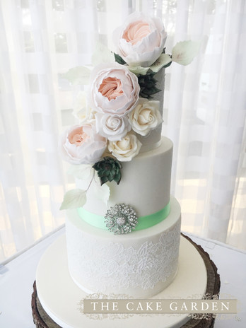 3 tier mint Eternity lace with sugar flowers