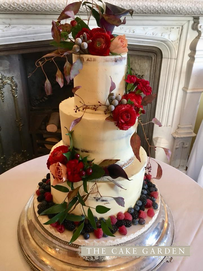 3 tier semi skimmed with wild and abundant fresh flowers and berries