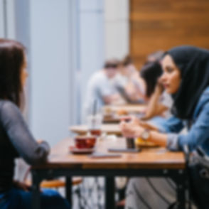 people-sitting-beside-tables-indoors-156