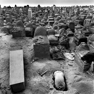 A grave-digger in the Wadi al-Salam cemetery. After ceremonies at the mausoleum of Imam Ali bodies are brought here, one of the largest cemeteries in the world. Families pay a fortune for 2 square meters of holy ground.