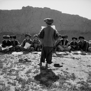 Since the Taliban have been defeated the UN has decided that all Afghan children have to attend school. But in most villages there are no schools left. Here in Arab Arzai 400 kids learn sitting on the grass. But not only the facilities are missing, there are no teachers left either. The students that know how to read try to teach to the ones that don't.
