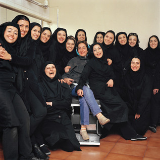 Mrs. Maryam Eqbali is the head of a all-female theater company that specializes inSaye-bazi a traditional form of shadow plays. She is photographed with her troupe. Iranshahr TheaterTehran, Iran, 12.2006.