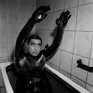 A man takes a bath in black gold. In Baku The 'Naftalan' clinic offers crude oil baths as a cure for arthritis, rheumatism, spondylitus, eczema, sciatica, infertility of the ovaries and radiculitis. Somehow the people of Baku seems convinced that oil will resolve all their problems. Oil has always played a main role in the history of the city; from when it propelled the Zoroastrian temples that Marco Polo speaks about to the first pipelines build here by the Nobel brothers in 1873. After the year of soviet dominance now it is the turn of the western companies to heavily invest on the shores of the Caspian sea.