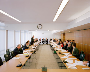 A meeting of The City of London Corporation's Policy and Resources Committee at the Guildhall, West Wing. The City of London Corporation is a unique combination of private company and public authority. It runs both The City and its vast property portfolio in and beyond the boundaries of the Square Mile. The City of London is the only part of Britain over which Parliament does not have full authority. The City's 8,000 residents have a right to vote, but the City's companies effectively can handpick three times as many non-resident voters, putting all decision-making power firmly in the hands of the financial companies based there. Over centuries The City of London has used its position as financier to the country to carve itself out special privileges, giving it an offshore flavour.  The City of London and the UK financial services industries work closely with the UK's Crown Dependencies and Overseas Territories, which include some of the world's biggest tax havens. City of London