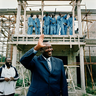 Claude Alphonse N'Silou, the Congolese minister of construction, at the Bacongo construction site in the capital. He himself has drawn the plans for the luxury villas of this complex, built by the Chinese company WIETC, at the place of hundreds of shacks that have been demolished. The undeclared objective of the Bacongo project is to substitute part of the population of the neighborhood, famous for being a stronghold of the Ninjas rebels that have fought here some of the most dramatic battles of the civil war (1997-2001). WIETC is also building Mr. N'Silou's new house, a palace that is being erected near the American embassy.