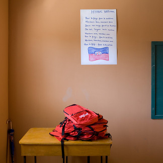 A classroom during the opening of a school financed by the Digicel telephone company. Backpacks with the company logo are distributed to the pupils. Saut d'Eau. Haiti