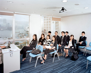 """Students of the """"Financial Consultant Trainees Initial Program"""" at GEO Securities, a Hong Kong-based asset management company, learn selling techniques. Mr. Francis Lun, the CEO of the company says, """"Hong Kong is the place you come to grab the money. Everything here is gambling. You have to learn how to gamble if you want to survive in Hong Kong."""" Hong Kong"""