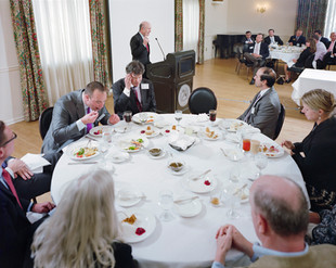 John E. Chapoton (standing) is the guest speaker at the monthly luncheon of the Wilmington Tax Group, where professionals gather to hear speakers on topics of policy, administration, and tax law. In his speech, Mr. Chapoton advocates for a tax reform in line with the Tax Reform Act of 1986, which, as assistant Secretary of the Treasury under President Reagan, he helped formulate. Under that reform, the top tax rate for individuals was lowered from 50% to 28%. Delaware.