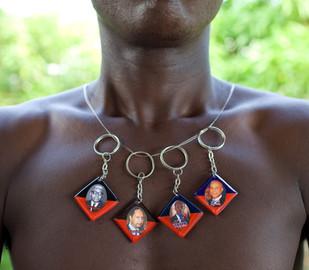Key chains with the portraits of four Haitian presidents: François Duvalier (1957-1971), Jean-Claude Duvalier (1971-1986), Jean-Bertrand Aristide (1990-1991; 1994-1997; 2002-2004), Michel Joseph Martelly (2011 - ). Les Cayes. Haiti, 2013