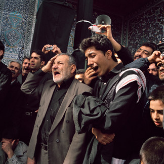 A crowd has gathered in the main mosque of the holy city of Qom for the religious festivity of Arba'een. They cry at the memory of the decapitation of the Imam Hossein, which occurred in the year 860 AD. Iran, Qom, February 2009.