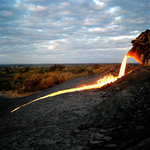 The waste of the copper smelting process is dumped in a field near the plant at Chambishi, in the Copperbelt province of Zambia. The price of copper has spiked reviving the entire region. 7500 dollars a ton in September 2008 at the London stock exchange: a 400% augmentation in four years.