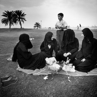 Palestinian women in a park at the foot of the HSBC Bank Tower. Because we interviewed and photographed these women we were called before the discreet but ever-present police of the emir. After three hours of interrogation, we left the police station with a brochure entitled, 'Islam and the Female Condition.'