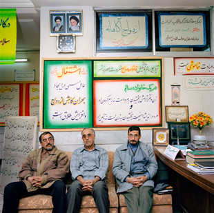 Said Sadr, on the left, and his two associates Seyed Mohammad Sayah Sarmadi, in the center, and Dr. Hadi Hadian, a mullah, here in civilian clothes. Together they run the Mashad Marriage School whose mission is to prepare the young for a healthy marriage. They also run a prostitution business on the side. Iran, Mashad, December 2006.