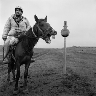 Namik Dadachov, professional pipeline guard on horseback. He covers about 20 kilometers a day, going back and forth along the Baku-Soupsa stretch of pipeline. His task: to communicate, by satellite phone, the presence of trespassers in a highly sensitive region near the Georgian border.