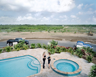 Caroline Thorburn (on the left), a realtor at Regal Realty, and Denise Gower, from the marketing agency Fountainhead, discuss a brand new development project in the south of Grand Cayman. It is fuelled by investments attracted to the Caymans by the country's tax-free environment. Grand Cayman