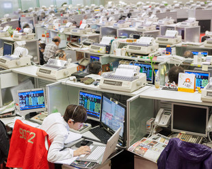 A trader at work at the Hong Kong Stock Exchange. The Hong Kong Stock Exchange is the sixth-largest in the world and the second in Asia in terms of value of shares traded. Hong Kong