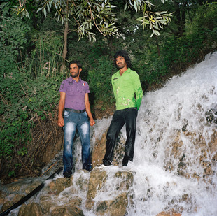 Hossein and Mohamad, 24 and 26, at a park in the outskirts of Shiraz where they have come to spend the day. This park, called Behesht Gomshode (lost paradise) is a place where dozens of family from Shiraz go to picnic and relax on the weekend. Iran, Shiraz, June 2009.