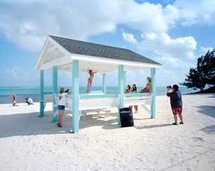 """Billy Ceravolo, 32, on the left with camera in hand, is the owner of the bikini brand TeenyB, whose motto is, """"Less fabric, more looks."""" She, the photographer and the models have come from Florida to the Caymans to snap images of the new fashion line. Besides being one of the major offshore centers in the world, the Cayman Islands are also a popular tourist destination. Grand Cayman"""