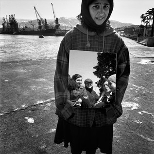 In the port of Batoumi, 'capital' of the separatist republic of Adjarie, a young gypsy girl offers passers-by a mirror in which to view themselves in return for a few cents.