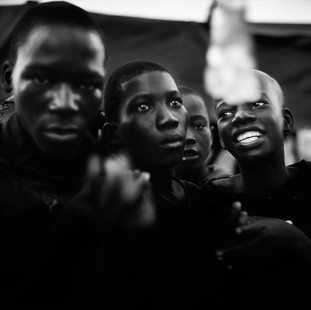 In the market of Roque Santeiro, one of the biggest in Africa, a gang of youths with blood shot eyes laugh wildly. They're drugged on 'gazolina' (turpentine) with which they deliberately soak their T-shirts.