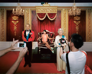 At Madame Tussauds in Hong Kong, visitors love to have their pictures taken with the wax statues of the Queen of England and her husband, Prince Philip. Hong Kong was a British colony for 156 years, until 1997, when sovereignty was transferred from the United Kingdom to the People's Republic of China. Hong Kong