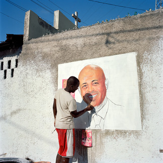 An artist hired by the Juvénat district support committee for the new president paints a portrait of Michel Joseph Martelly on Inauguration Day, Pétion-Ville. Haiti, 2011