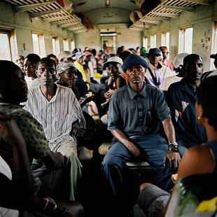 Passengers on the train that goes from Lobito to Cubal. This is the only working stretch of the southern railroad system that used to connect Angola to RDC and Zambia. The Chinese holding company CIF that was supposed to restore the railroad system, one of the lifelines of the country, is running late and is bugged down with scandals.