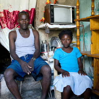 Wilfrid Joseph with Rosemène, a restavek who has been living with him since her parents entrusted him with her several years ago. The phenomenon of these child servants affects nearly 225,000 children in the country according to UNICEF. Pétion-Ville. Haiti