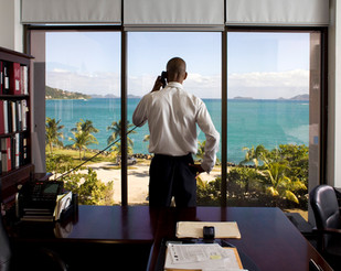 Mr. Neil M. Smith is the British Virgin Islands' Finance Secretary, photographed here in his office in Road Town, Tortola. The BVI is one of the world's most important offshore financial service centers and the world leader for incorporating companies. There are more than 800,000 companies based in the BVIs but only 28,000 inhabitants. The BVIs are the second-biggest direct investors in China, just after Hong Kong. British Virgin Islands