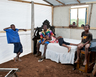 The Macius family children, in their tent in Canaan. The parents are out working. Croix-des-Bouquets. Haiti