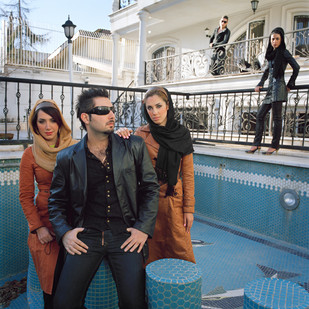 """Mahsan, Yashar, Elham, Mahriar et Arzaneh (from left to right) are all between 19 and 24 and are photographed in swimming pool that is kept empty as the laws of the Islamic republic forbid pool's use if the neighbors can see the bathers. They are part of an Iranian upper middle class awash in oil money. They live in an egoist and narcissistic world with interests that revolve mainly around money, fashion and sex. Yashar affirms, """"The biggest problem in Tehran today is to find a girl that at 16 is still a virgin"""".  Iran, Tehran, February 2009."""