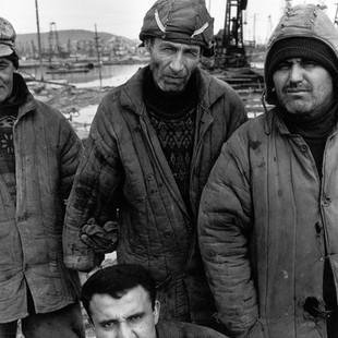 A team of welders  belonging to Socar, the Azeri state company, here to repair facilities on the old Bibi Heybat oil field. The workmen are paid 60 dollars a month and they survive with help from exiled cousins in Russia. The same work, when done for BP, is paid 500 dollars.