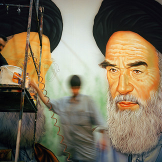 In the atelier of the painter Khosrow Karami in the south suburb of Rey, an employee is working on a giant Khomeini Khamenei portrait that will be put in the streets of Tehran. Painter Khosrow Karami has been fundamental in creating part of the iconography of the regime.  Iran, Tehran, June 2005.