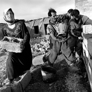 About one hundred Kurdish families are putting up homes at an impressive rate on land around Rahimaya. Chased off in 1987 they now have all the fervor of settlers.