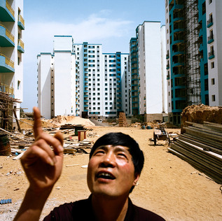 A Chinese technician for CSCEC in the brand new neighbourhood of Bananier Bis. The apartments will be consigned in a couple of weeks. It is the first time that a multitude of 15 storey high housing projects are built in Algeria. Here the Chinese construction company CSCEC, giant of the sector with 122.000 workers in China, is building thousands of apartments for the Algerian government that is facing an unprecedented housing shortage. CSCEC has built 30.000 of the 55.000 apartments of this nation wide housing project.