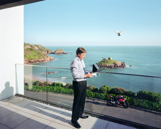 Mark Loane flies one of his drones at his home in Jersey. Mr. Loane is the CEO of C5 Alliance Group, a full-service IT business that provides a wide variety of technology services, such as Internet banking, FATCA compliance and cloud computing, to the offshore operations of companies like Lloyds, Standard Bank, and Generali, among others. C5 is also a technology partner in the Channel Islands' rapidly developing eGaming sector. Jersey