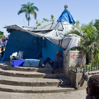After the January 12, 2010, earthquake, the capital's public squares were taken over by displaced people living in tents. Here, an equestrian statue of Jean-Pierre Boyer, president from 1818 to 1843, is used to support a tent made of tarps from international aid organizations. Place Boyer, Pétion-Ville. Haiti, 2011