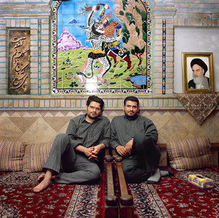 Ehsan Ramezan-Ali, 27 (on the left), and his brother Sadjad, 22, have always been very different. Ehsan loves pop music while Sadjad listens to the call to prayer. Ehsan is a fan of Robert de Niro and his movies but Sadjad only watches Iranian war films. Until the 12th of June 2009 the two brothers lived more or less peacefully in a small room in their parents house in the south of Tehran. The disputed results of the presidential election have put them against each other. Sadjad is an active member of the Basij, the paramilitary militia that has had a major role in repressing the anti-Ahmadinejad rallies. He spends his nights patrolling the roads of the capital with a baton in his hand. His older brother Ehsan, a partisan of the reformist candidate Mir Hussein Moussavi, was involved in the election campaign and now takes part in the daily rallies. Shar-e Rey, Southern suburb of Tehran, June 2009.