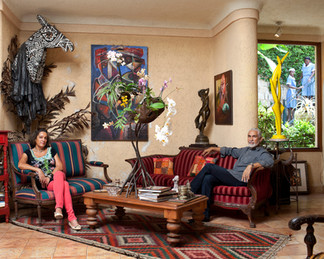 Philippe Dodard and his wife Raphaëlle Villard in their living room. An artist and the director of the National Arts School, his abstract sculptures are part of many private corporate collections. Raphaëlle Villard is known for cultivating rare types of orchids. Montagne Noire. Haiti