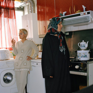 Maryam, 33 (on the left), a single mother and painter, teaches art and art history at a high school in Tehran. All her students are girls aged fourteen to eighteen. 'Girls today are cleverer than in my generation,' she says. 'They know what they want and they demand their rights.' She lets her students remove their headscarves in class and pushes the boundaries of the Islamic dress code for her live classes. 'In most classes, models have to wear a headscarf and manteau (a sort of house coat). I let them pose in a t-shirt and trousers. I got in a bit of trouble for it.' Pictured here with her mother, Maryam is part of a close family. 'I have six brothers and sisters. When my father died my brothers took over his hardware store. We spend all our free time together at my mother's house. It's good but it can get claustrophobic.'  Iran, Tehran, August 2006.